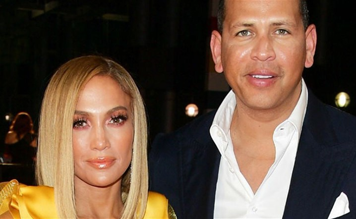 Jennifer Lopez and Alex Rodriguez Kiss in Matching Christmas Pajamas